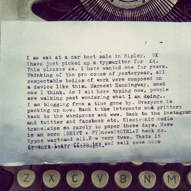 Some typed copy text on a sheet of paper on a typewriter.
